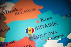 Moldova marked with a flag on the map.  stock image