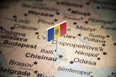 Moldova marked with a flag on the map.  royalty free stock photos