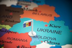 Moldova marked with a flag on the map.  stock photography