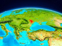 Moldova from orbit. Satellite view of Moldova highlighted in red on planet Earth. 3D illustration. Elements of this image furnished by NASA Royalty Free Stock Photography