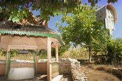 Moldova, Orhei Vechi, well and a wayside shrine Royalty Free Stock Image