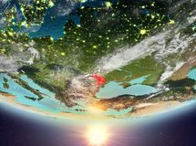Moldova with sun. Moldova during sunrise highlighted in red on planet Earth with clouds. 3D illustration. Elements of this image furnished by NASA Stock Images