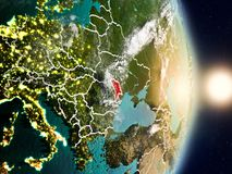 Moldova during sunrise. Highlighted in red on planet Earth with visible country borders. 3D illustration. Elements of this image furnished by NASA Stock Image