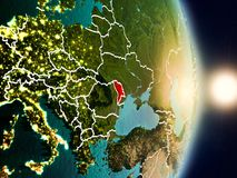 Moldova during sunrise. Highlighted in red on planet Earth with visible country borders. 3D illustration. Elements of this image furnished by NASA Royalty Free Stock Photos