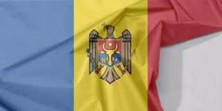 Moldova tkaniny flaga zagniecenie z biel przestrzenią i krepa obraz royalty free