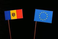 Moldovan flag with European Union EU flag isolated on black. Background Royalty Free Stock Image