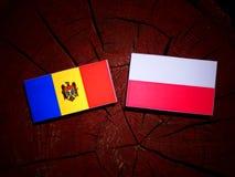 Moldovan flag with Polish flag on a tree stump isolated. Moldovan flag with Polish flag on a tree stump vector illustration