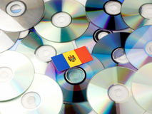 Moldovan flag on top of CD and DVD pile isolated on white. Moldovan flag on top of CD and DVD pile isolated Royalty Free Stock Photos