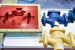 Molds and plastic products. Molds for casting and plastic products Stock Images