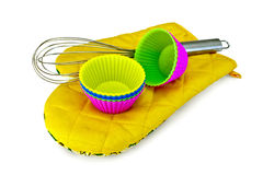 Molds for cupcakes with mixer on potholder Stock Image