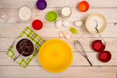 Molds and ingredient for baking cupcake and muffins royalty free stock photography