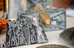 Molds and supplies for making antique tin soldiers Royalty Free Stock Photography