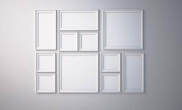 Moldura para retrato branca na parede branca Fotos de Stock