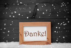 A moldura para retrato com meios de Danke agradece-lhe, neve, flocos de neve Imagens de Stock