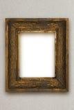A moldura para retrato de madeira velha clássica cinzelou à mão o papel de parede cinzento Imagens de Stock