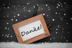 A moldura para retrato, meios de Danke agradece-lhe, neve, flocos de neve fotos de stock