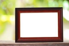 Moldura para retrato moderna colocada em um assoalho de madeira fotos de stock