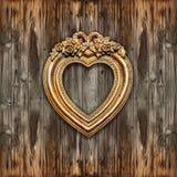 Moldura para retrato retro grande da forma do coração do ouro Fotos de Stock Royalty Free