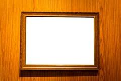 Molduras para retrato com o espaço vazio isolado no fundo de madeira Fotos de Stock