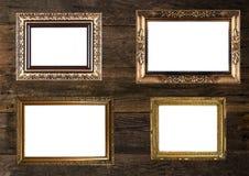 Molduras para retrato do ouro velho na parede de madeira Imagem de Stock Royalty Free