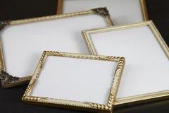 Molduras para retrato vazias, ouro Fotografia de Stock