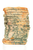 Moldy Bread Loaf. Moldy sliced bread loaf, over white background Royalty Free Stock Images