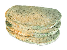Moldy bread slices. On white background Royalty Free Stock Photos
