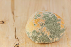 Moldy bread on wood background. Bad food Royalty Free Stock Photography