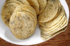 Moldy potato chips Stock Photos