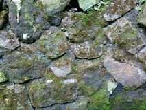 Moldy stone wall on a retaining wall soften the stone hard impression stock images