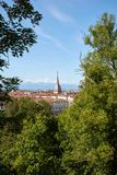 Mole Antonelliana tower and Turin city framed by trees in a sunny day in Italy. Mole Antonelliana tower and Turin city framed by trees in a sunny summer day in stock image