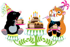 Mole and hamster eating birthday cake Stock Image