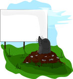 Mole on molehill looking at a billboard. Stock Images