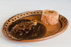 Mole Poblano with Chicken and rice is Mexican Food in Puebla Mexico royalty free stock photography