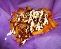 Mole Sauce and Cheese French Fries royalty free stock photos