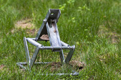Mole trap sprung. A sprung mole trap in a yard Royalty Free Stock Images
