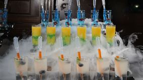 Molecular cuisine concept. Set of beverages on black background with liquid nitrogen pouring. Molecular table setting