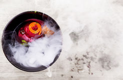 Molecular Cuisine. Delicious soup with beetroot. Stock Photos