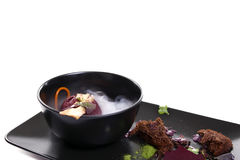 Molecular Cuisine. Delicious soup with beetroot. Royalty Free Stock Photos
