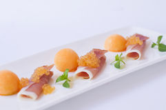 Molecular melon caviar, prosciutto and fresh melon Stock Photo