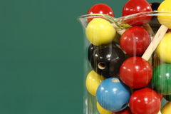 Molecular model: wooden balls in a beaker. On a background of green blackboard Stock Photography