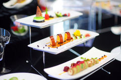 Molecular modern cuisine. Various fancy dishes on white plates in a restaurant. Royalty Free Stock Photography