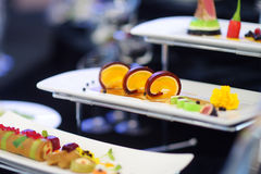 Molecular modern cuisine. Various fancy dishes on white plates in a restaurant. Stock Photos