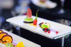 Molecular modern cuisine. Various fancy dishes on white plates in a restaurant. Royalty Free Stock Images
