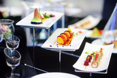 Molecular modern cuisine. Various fancy dishes on white plates in a restaurant. Royalty Free Stock Photo