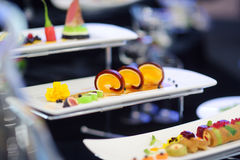 Molecular modern cuisine. Various fancy dishes on white plates in a restaurant. Stock Photography