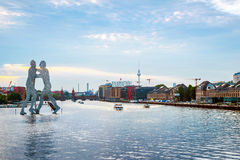 Molecule men with Tv tower in Berlin Stock Image