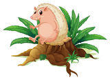 A molehog sitting on the stump with leaves Stock Photos