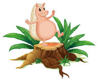 A molehog standing on the stump with leaves Stock Photo