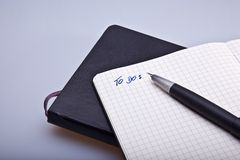 Moleskine notebook. A open moleskine notebook with a page titled To Dos Royalty Free Stock Photography